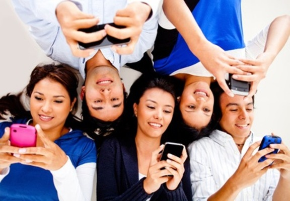 Young people texting on phones
