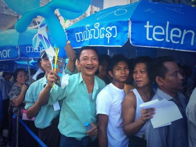 Telenor Myanmar: Long queue for buying their first mobile SIM in Yangon