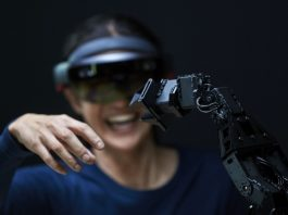 Woman using AR to control robotic arm